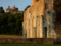 Abbey of San Galgano (ruins of a Cistercian Monastery) and Montesiepi Chapel in the background.
